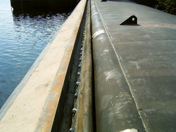 A rubber compression sill seat at Hatfield Dam was built to ensure a tight seal when the hydraulic crest gates need to be closed.