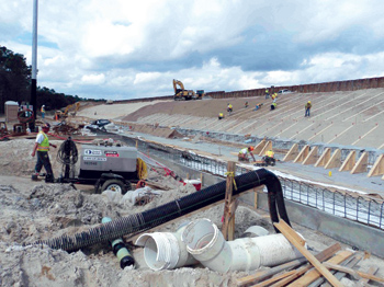Workers are shown during the stilling basin construction phase of the Jackson Bluff project renovation.