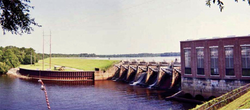 This view of the Jackson Bluff Dam shows the project's powerhouse (right), gated spillway and embankment. Jackson Bluff, owned by the city of Tallahasse, Fla., is one of just two hydroelectric projects in Florida.