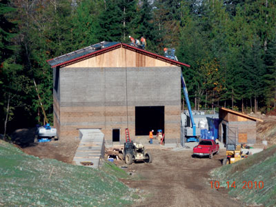 The powerhouse for the 7.5-MW Youngs Creek project in Washington State is a concrete block structure with a metal roof. It contains a single two-jet horizontal Pelton turbine.