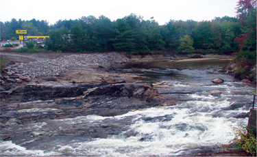 A ground-level view of the Souhegan River after the Merrimack Village Dam and its apron were removed shows the river in its more natural state as well as some of the work done to fortify the shoreline.