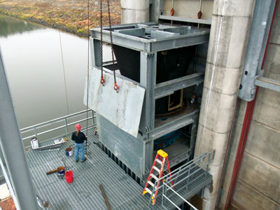One of the two turbines at the Jordan hydroelectric project is shown being installed into the tower in its power module. Each unit has an installed capacity of 2.2 MW.