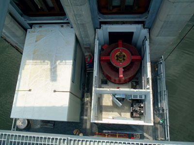 Both generators are covered by 180-ton steel enclosures, as shown here.