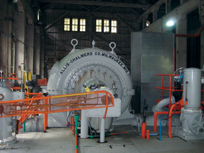 The Allis Chalmers horizontal Francis turbine inside the powerhouse drives a 4.7-MW capacity generator.