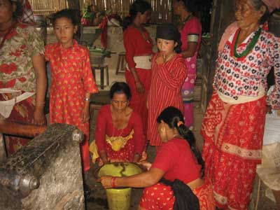 Before electricity was readily available, using an oil expeller was very labor intensive and difficult work for locals, especially women. The electric oil expeller shown above has made getting cooking oil from mustard and other seeds a faster and simpler process. (Photo courtesy Suman Basnet)