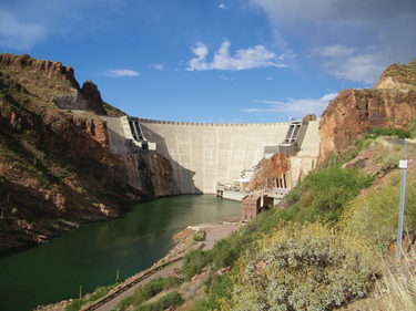 Located northeast of Phoenix, Ariz., Horse Mesa Dam is 305 feet high and 600 feet long and impounds Apache Lake.