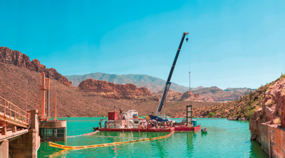 With the intake of Unit 4 located 160 feet under the surface of Apache Lake, the base for the divers was installed as a barge over the intake structure to facilitate efficient transport to the intake.
