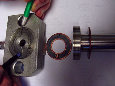 The pens indicate an undesirable flow path on the sealing surface of this block, which was bolted to the shoe on the outside diameter.