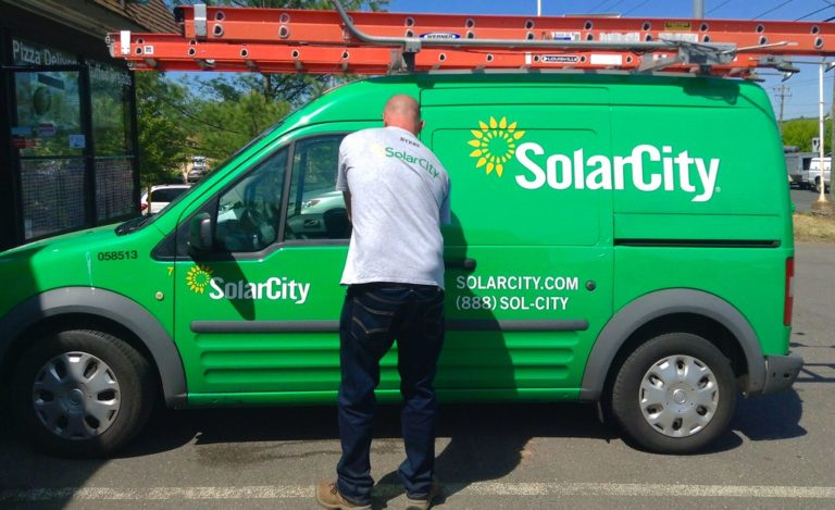 Musk says shifting SolarCity workers helped Tesla stay afloat